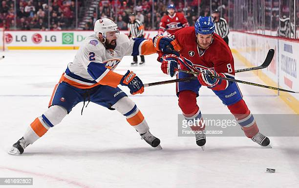 Brandon Prust of the Montreal Canadiens skates for the puck against Nick Leddy of the New York Islanders in the NHL game at the Bell Centre on...