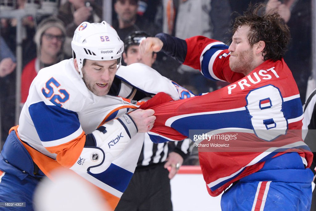 Brandon Prust #8 of the Montreal Canadiens throws a punch at Joe Finley #52 of the New York Islanders during the NHL game at the Bell Centre on February 21, 2013 in Montreal, Quebec, Canada.