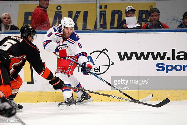Brandon Prust of the New York Rangers makes a pass against Luca Sbisa of the Anaheim Ducks at the Globe Arena during the 2011 NHL Compuware Premiere...