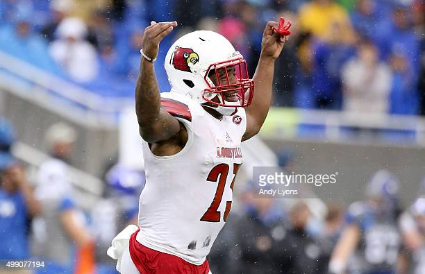 Brandon Radcliff of the Louisville Cardinals celebrates after scoring a touchdown during the game against the Kentucky Wildcats at Commonwealth...