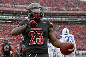 Brandon Radcliff of the Louisville Cardinals celebrates as he runs for a touchdown during the game against the Kentucky Wildcats at Papa John's...