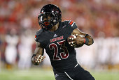Brandon Radcliff of the Louisville Cardinals runs with the ball during the game against the Murray State Racers at Papa John's Cardinal Stadium on...