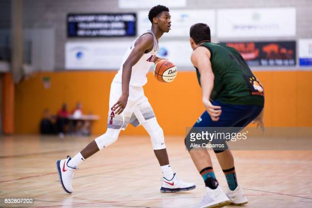 Brandon Randolph of the Arizona Wildcats advances against Carles Homs of the Mataro AllStars during the Arizona In Espana Foreign Tour game between...