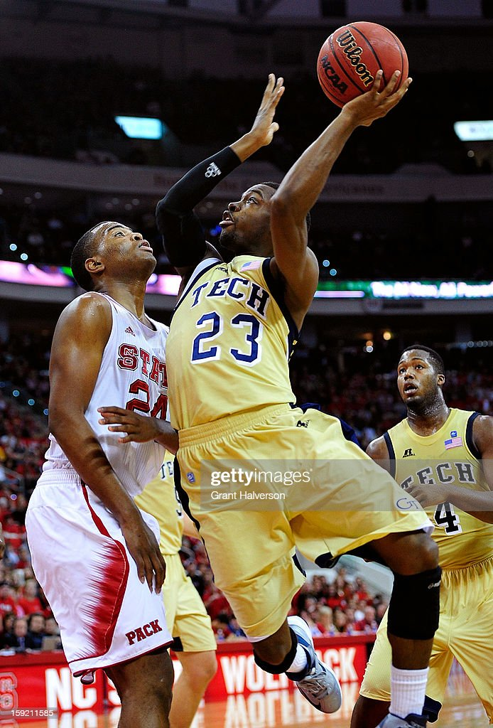Brandon Reed #23 of the Georgia Tech Yellow Jackets shoots over T.J. Warren #24 of the North Carolina State Wolfpack during play at PNC Arena on January 9, 2013 in Raleigh, North Carolina.