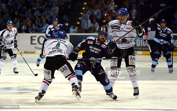 Brandon Reid of Hamburg battles for the puck with Robert Brown of Augsburg during the DEL match between Hamburg Freezers and Augsburger Panther at O2...