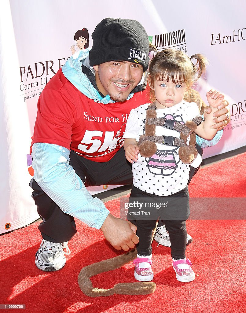 Brandon Rios and his daughter Mia attend the PADRES Contra El Cancer's 'Stand For HOPE!' 5K Run/Walk held at Rose Bowl on June 24, 2012 in Pasadena, California.