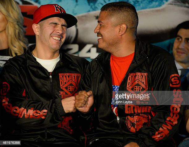 Brandon Rios fist bumps his trainer Robert Garcia during a press conference with Mike Alvarado January 22 2015 for the upcoming WBO International...