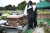 Brandon Risher is comforted as he spends time at the casket of his grandmother Ethel Lance who was one of nine victims of a mass shooting at the...