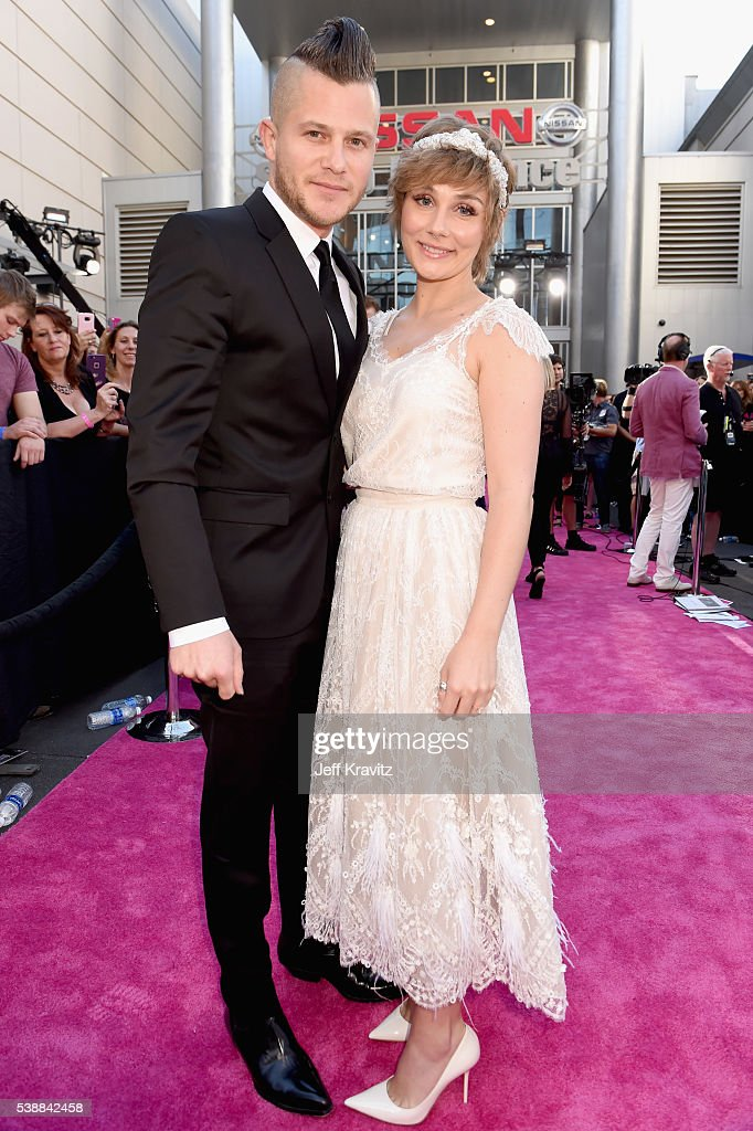 Brandon Robert Young and Clare Bowen attend the 2016 CMT Music awards at the Bridgestone Arena on June 8 2016 in Nashville Tennessee