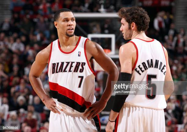 Brandon Roy and Rudy Fernandez of the Portland Trail Blazers talk on the court during the game against the New Jersey Nets at The Rose Garden on...