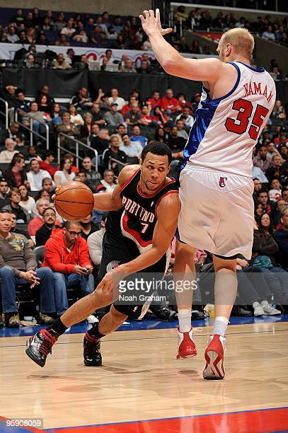 Brandon Roy of the Los Angeles Clippers drives the ball against Chris Kaman of the Portland Trail Blazers during the game on January 4 2010 at...