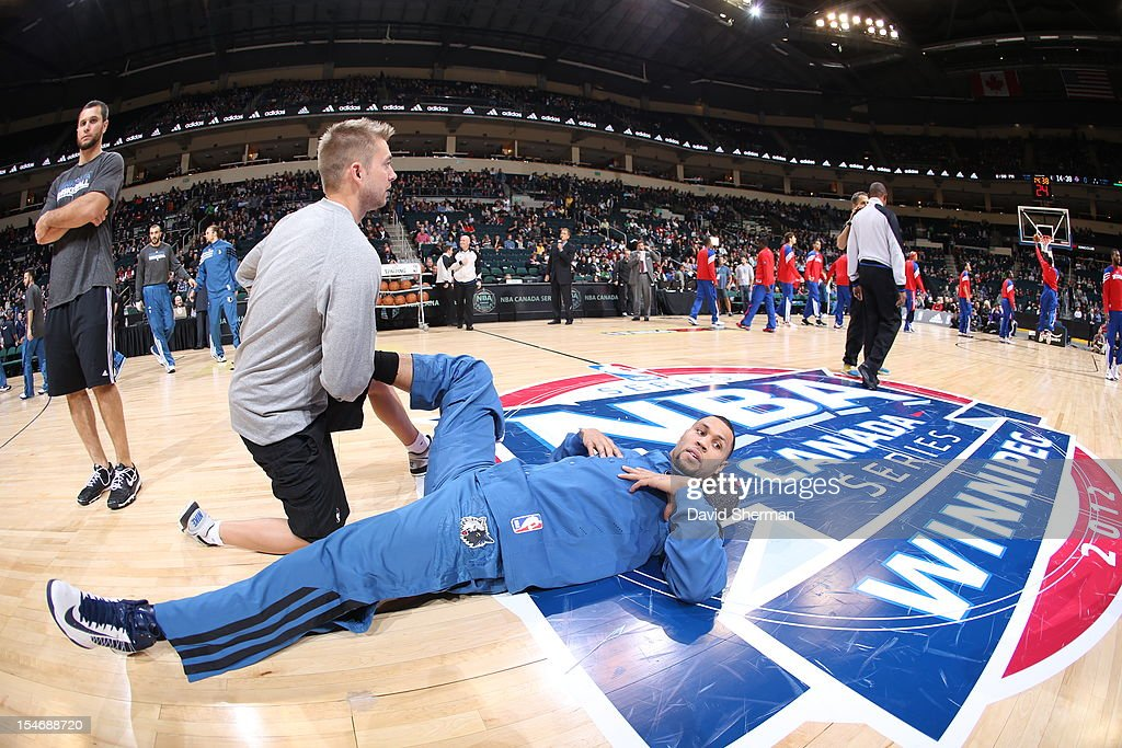 Brandon Roy #3 of the Minnesota Timberwolves is stretched by Assistant Athletic trainer David Crew during the game between the Minnesota Timberwolves and the Detroit Pistons during the NBA preseason as part of NBA Canada Series 2012 on October 24, 2012 at the MTS Centre in Winnipeg, Manitoba, Canada.