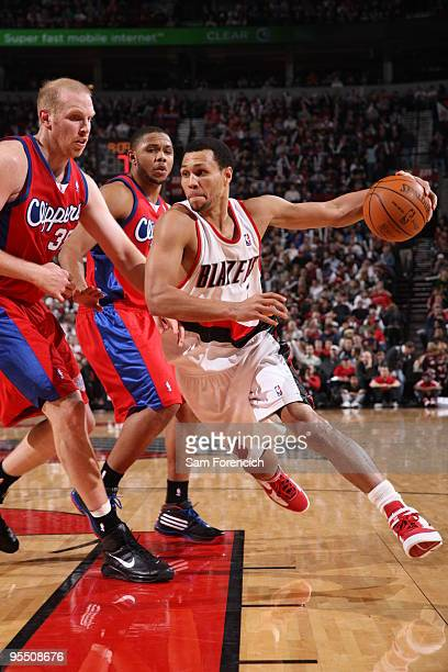 Brandon Roy of the Portland Trail Blazers drives against Chris Kaman of the Los Angeles Clippers during a game on December 30 2009 at the Rose Garden...