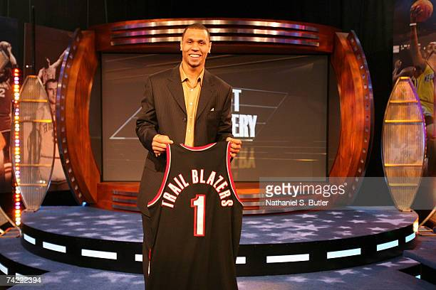 Brandon Roy of the Portland Trail Blazers holds up a jersey as they get they get the number one pick during the 2007 NBA Draft Lottery on May 22 2007...