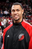 Brandon Roy of the Portland Trail Blazers looks on with a smile during the game against the Atlanta Hawks at The Rose Garden on November 3 2009 in...
