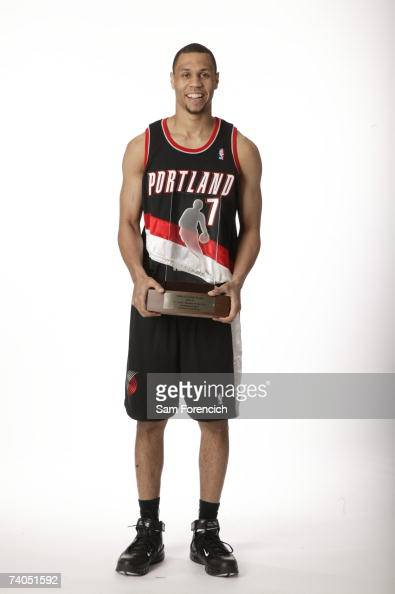 Brandon Roy of the Portland Trail Blazers poses with the Eddie Gottlieb Trophy awarded in honor of Roy's selection as the 200607 TMobile Rookie of...