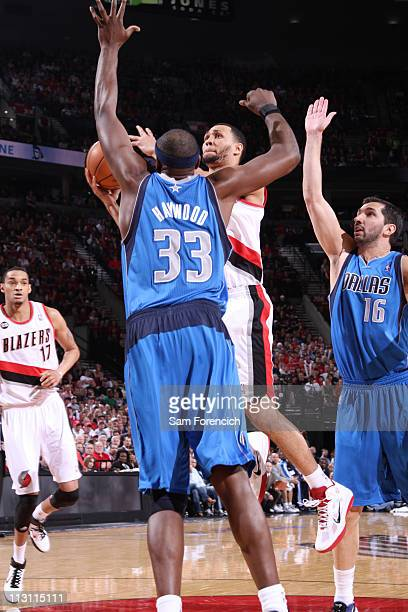 Brandon Roy of the Portland Trail Blazers shoots against Brendan Haywood of the Dallas Mavericks in Game Four of the Western Conference Quarterfinals...