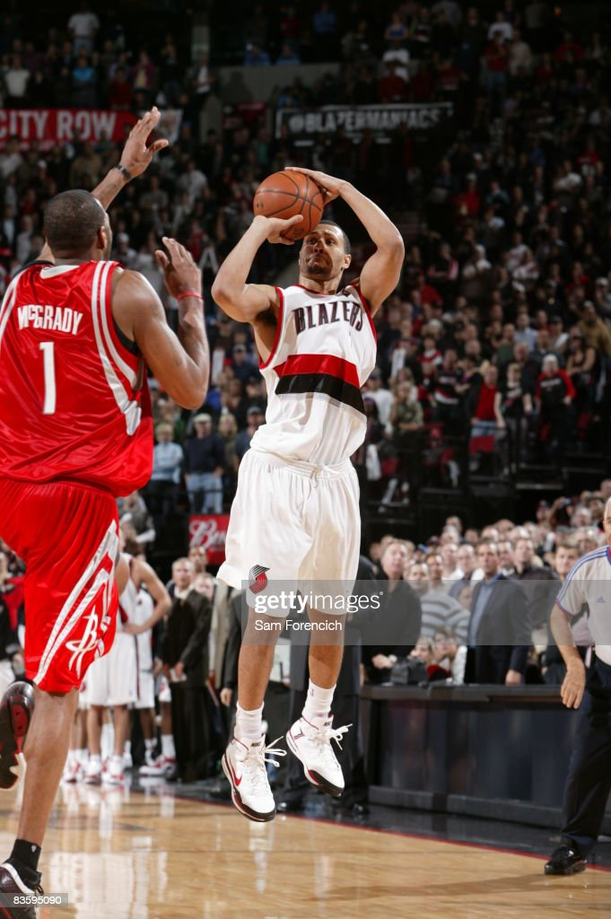 Brandon Roy of the Portland Trail Blazers takes the game winning shot over Tracy McGrady of the Houston Rockets during a game on November 6 2008 at...