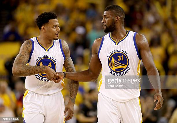 Brandon Rush and Festus Ezeli of the Golden State Warriors celebrate during Game 2 of the 2016 NBA Finals against the Cleveland Cavaliers at ORACLE...