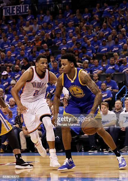 Brandon Rush of the Golden State Warriors drives against Andre Roberson of the Oklahoma City Thunder in the fourth quarter in game three of the...