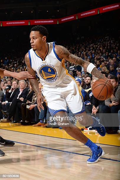 Brandon Rush of the Golden State Warriors drives to the basket against the Milwaukee Bucks on December 18 2015 at Oracle Arena in Oakland California...