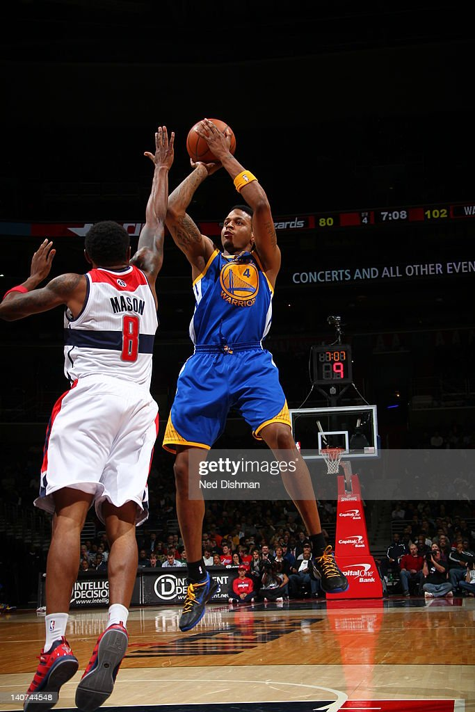 <a gi-track='captionPersonalityLinkClicked' href=/galleries/search?phrase=Brandon+Rush+-+Basketball+Player&family=editorial&specificpeople=802089 ng-click='$event.stopPropagation()'>Brandon Rush</a> #4 of the Golden State Warriors goes for a jump shot against Roger Mason #8 of the Washington Wizards during the game between the Washington Wizards and the Golden State Warriors at the Verizon Center on March 5, 2012 in Washington, DC.