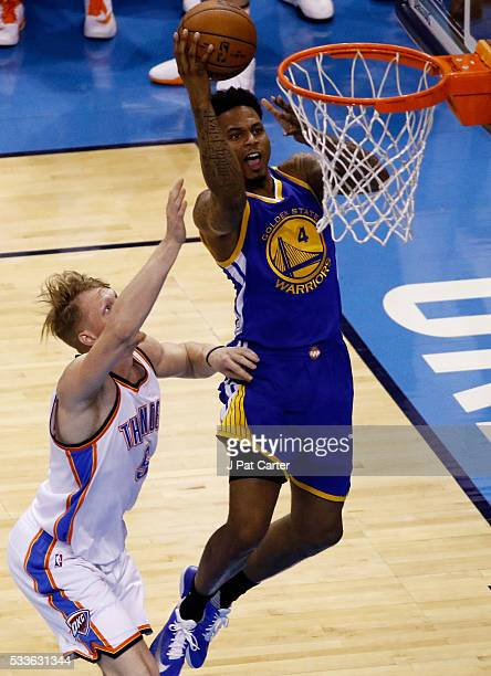 Brandon Rush of the Golden State Warriors goes up against Kyle Singler of the Oklahoma City Thunder in game three of the Western Conference Finals...