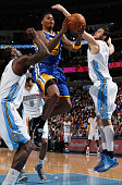 Brandon Rush of the Golden State Warriors lays up a shot against JJ Hickson and Danilo Gallinari of the Denver Nuggets at Pepsi Center on March 13...