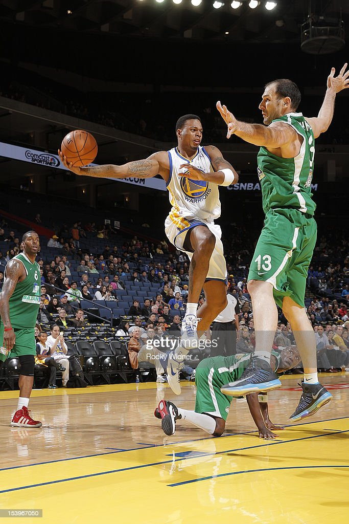 <a gi-track='captionPersonalityLinkClicked' href=/galleries/search?phrase=Brandon+Rush+-+Basketball+Player&family=editorial&specificpeople=802089 ng-click='$event.stopPropagation()'>Brandon Rush</a> #4 of the Golden State Warriors looks to pass the ball against Ido Kozikaro #13 of the Maccabi Haifa on October 11, 2012 at Oracle Arena in Oakland, California.