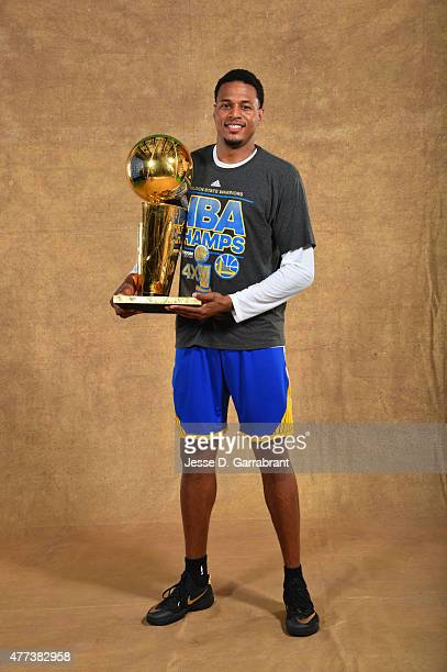 Brandon Rush of the Golden State Warriors poses for a portrait with the Larry O'Brien trophy after defeating the Cleveland Cavaliers in Game Six of...