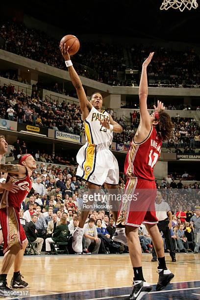Brandon Rush of the Indiana Pacers shoots over Anderseon Varejao of the Cleveland Cavaliers at Conseco Fieldhouse on April 13 2009 in Indianapolis...