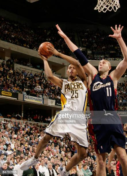 Brandon Rush of the Indiana Pacers shoots over Zydrunas Ilagauskas of the Cleveland Cavaliers at Conseco Fieldhouse on February 10 2009 in...