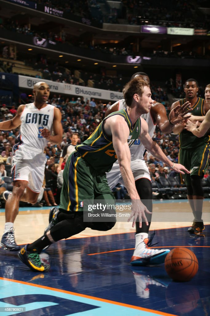 Brandon Rush #25 of the Utah Jazz drives against the Charlotte Bobcats during the game at the Time Warner Cable Arena on December 21, 2013 in Charlotte, North Carolina.