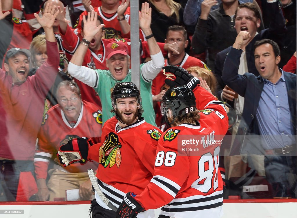 Brandon Saad #20 and Patrick Kane #88 of the Chicago Blackhawks celebrate after Saad scored against the Los Angeles Kings in the first period in Game Five of the Western Conference Final during the 2014 NHL Stanley Cup Playoffs at the United Center on May 28, 2014 in Chicago, Illinois.