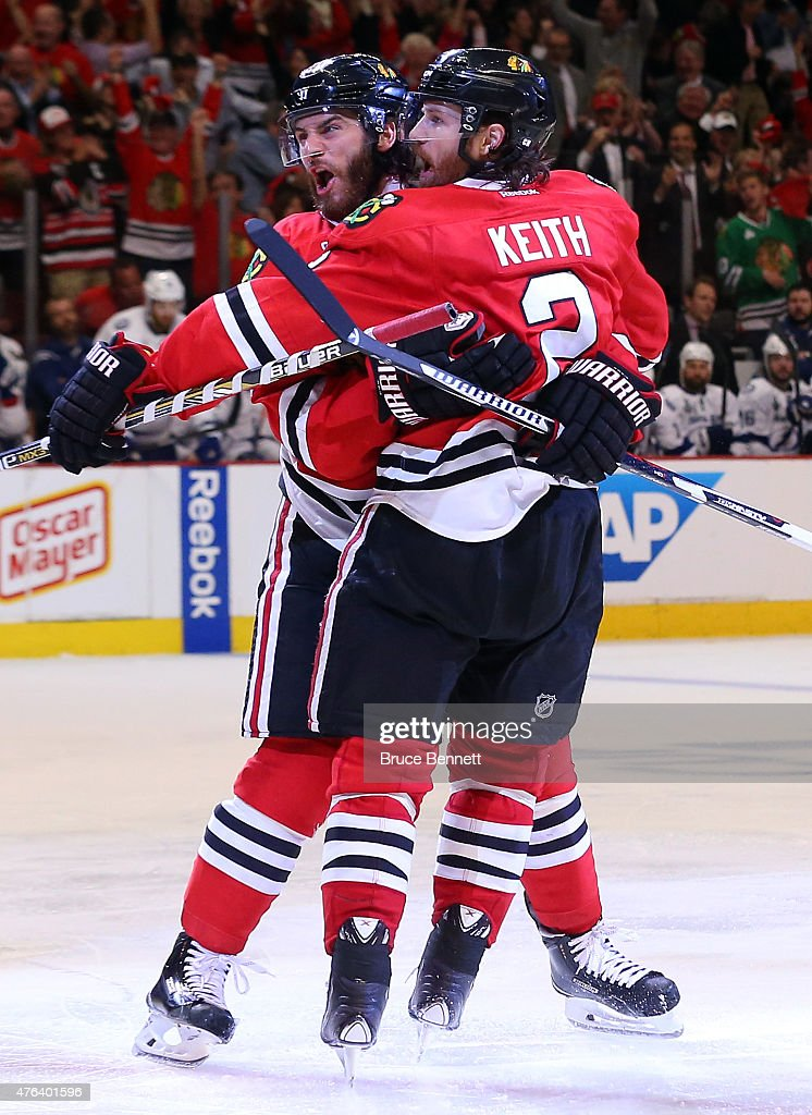 Brandon Saad celebrates a third period goal with Duncan Keith of the Chicago Blackhawks against the Tampa Bay Lightning during Game Three of the 2015...