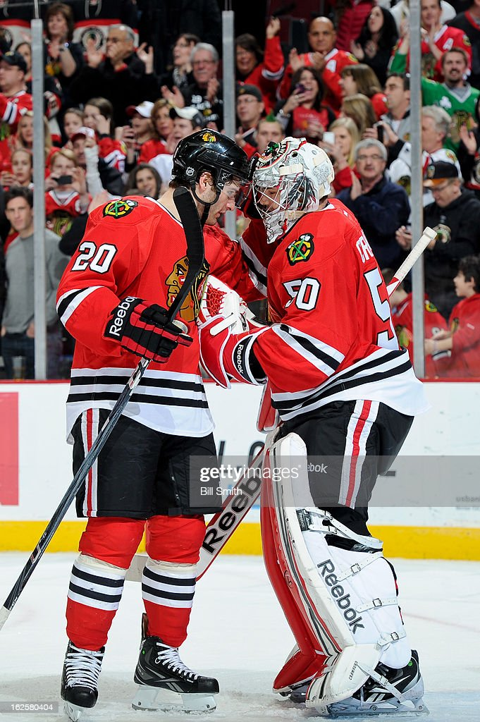 Brandon Saad #20 celebrates a win with goalie <a gi-track='captionPersonalityLinkClicked' href=/galleries/search?phrase=Corey+Crawford&family=editorial&specificpeople=818935 ng-click='$event.stopPropagation()'>Corey Crawford</a> #50 of the Chicago Blackhawks after the NHL game against the Columbus Blue Jackets on February 24, 2013 at the United Center in Chicago, Illinois.