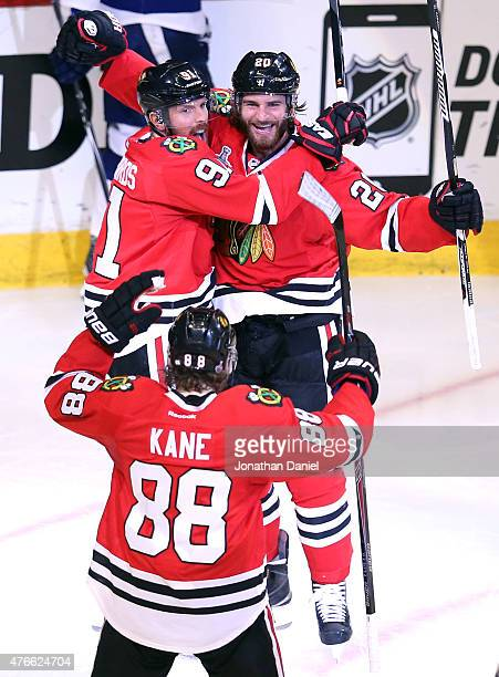 Brandon Saad celebrates with Brad Richards and Patrick Kane of the Chicago Blackhawks after scoring a goal in the third period against the Tampa Bay...