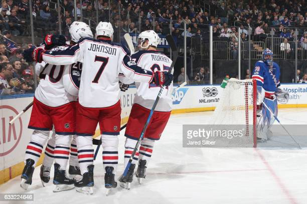 Brandon Saad Jack Johnson and Ryan Murray of the Columbus Blue Jackets celebrate after scoring a goal in the second period against Henrik Lundqvist...