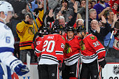 Brandon Saad Marian Hossa and Michal Rozsival of the Blackhawks celebrate after scoring against the Tampa Bay Lightning in the second period of the...