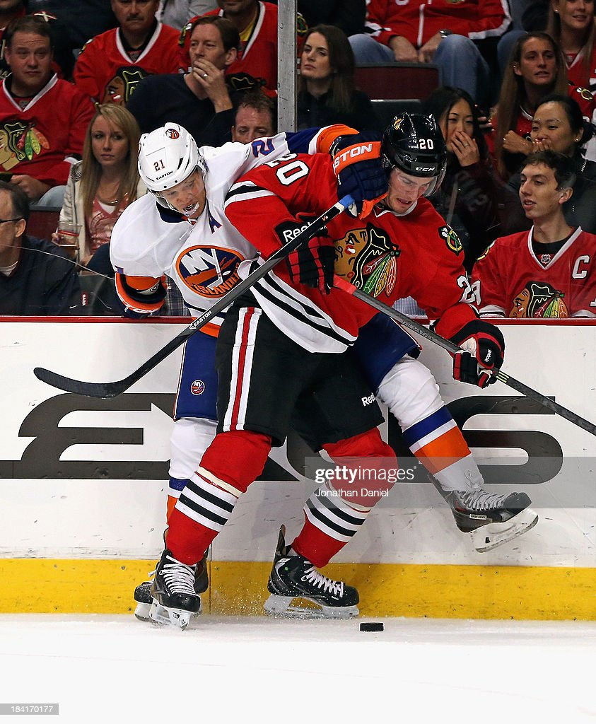 <a gi-track='captionPersonalityLinkClicked' href=/galleries/search?phrase=Brandon+Saad&family=editorial&specificpeople=7128385 ng-click='$event.stopPropagation()'>Brandon Saad</a> #20 of the Chicago Blackhawks and <a gi-track='captionPersonalityLinkClicked' href=/galleries/search?phrase=Kyle+Okposo&family=editorial&specificpeople=540469 ng-click='$event.stopPropagation()'>Kyle Okposo</a> #21 of the New York Islanders battle for the puck along the boards at the United Center on October 11, 2013 in Chicago, Illinois.