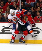 Brandon Saad of the Chicago Blackhawks and Kyle Okposo of the New York Islanders battle for the puck along the boards at the United Center on October...