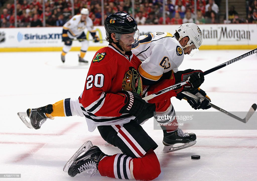 Brandon Saad of the Chicago Blackhawks and Mike Ribeiro of the Nashville Predators battle for the puck in Game Three of the Western Conference...