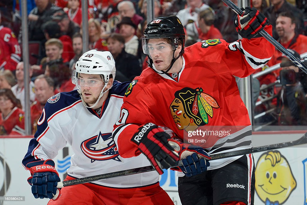 Brandon Saad #20 of the Chicago Blackhawks and <a gi-track='captionPersonalityLinkClicked' href=/galleries/search?phrase=Tim+Erixon+-+Ice+Hockey+Player&family=editorial&specificpeople=8546945 ng-click='$event.stopPropagation()'>Tim Erixon</a> #20 of the Columbus Blue Jackets look down the ice during the NHL game on February 24, 2013 at the United Center in Chicago, Illinois.