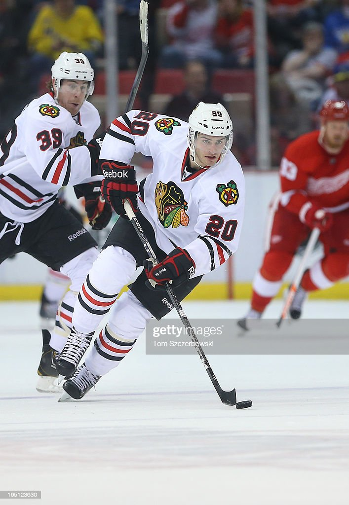 <a gi-track='captionPersonalityLinkClicked' href=/galleries/search?phrase=Brandon+Saad&family=editorial&specificpeople=7128385 ng-click='$event.stopPropagation()'>Brandon Saad</a> #20 of the Chicago Blackhawks carries the puck during an NHL game against the Detroit Red Wings at Joe Louis Arena on March 31, 2013 in Detroit, Michigan.