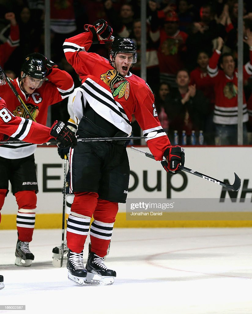 <a gi-track='captionPersonalityLinkClicked' href=/galleries/search?phrase=Brandon+Saad&family=editorial&specificpeople=7128385 ng-click='$event.stopPropagation()'>Brandon Saad</a> #20 of the Chicago Blackhawks celebrates a third period goal against the Nashville Predators at the United Center on April 7, 2013 in Chicago, Illinois. The Blackhawks defeated the Predators 5-3.