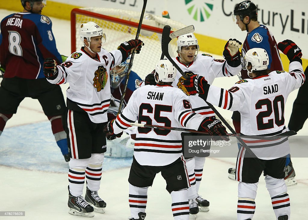<a gi-track='captionPersonalityLinkClicked' href=/galleries/search?phrase=Brandon+Saad&family=editorial&specificpeople=7128385 ng-click='$event.stopPropagation()'>Brandon Saad</a> #20 of the Chicago Blackhawks celerbates his goal against the Colorado Avalanche with <a gi-track='captionPersonalityLinkClicked' href=/galleries/search?phrase=Jonathan+Toews&family=editorial&specificpeople=537799 ng-click='$event.stopPropagation()'>Jonathan Toews</a> #19, Andrew Shaw #65 and Patrick Kane #88 of the Chicago Blackhawks in the third period at Pepsi Center on March 12, 2014 in Denver, Colorado. The Avalanche defeated the Blackhawks 3-2.