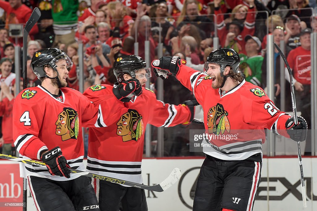 <a gi-track='captionPersonalityLinkClicked' href=/galleries/search?phrase=Brandon+Saad&family=editorial&specificpeople=7128385 ng-click='$event.stopPropagation()'>Brandon Saad</a> #20 of the Chicago Blackhawks celebrates with Marcus Kruger #16 and <a gi-track='captionPersonalityLinkClicked' href=/galleries/search?phrase=Niklas+Hjalmarsson&family=editorial&specificpeople=2006442 ng-click='$event.stopPropagation()'>Niklas Hjalmarsson</a> #4 after scoring against the Anaheim Ducks in the first period in Game Four of the Western Conference Finals during the 2015 NHL Stanley Cup Playoffs at the United Center on May 23, 2015 in Chicago, Illinois.