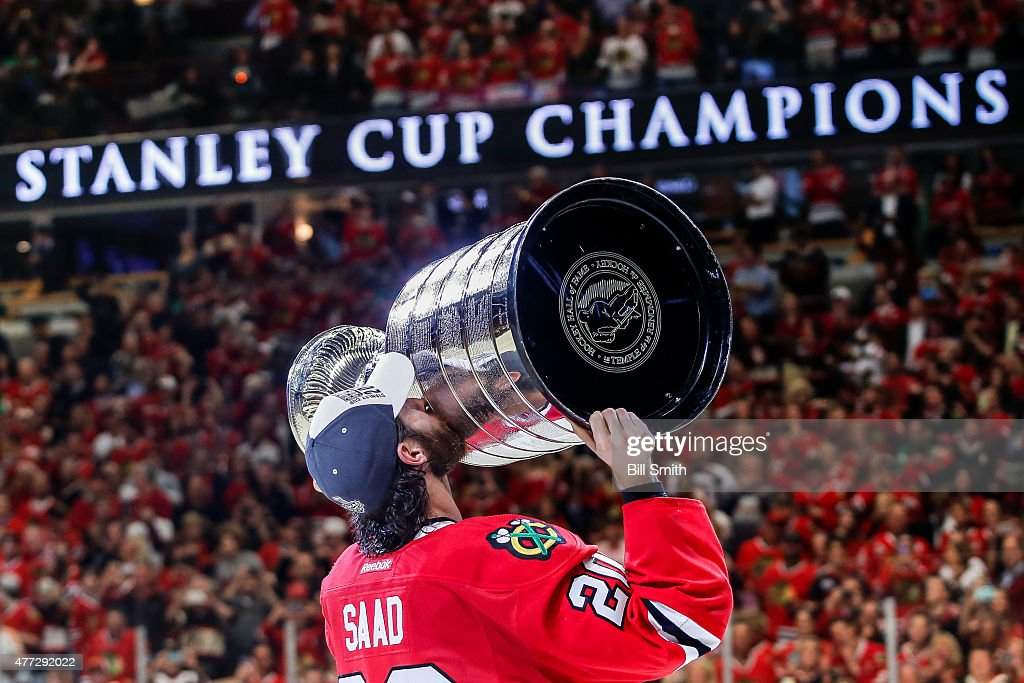 <a gi-track='captionPersonalityLinkClicked' href=/galleries/search?phrase=Brandon+Saad&family=editorial&specificpeople=7128385 ng-click='$event.stopPropagation()'>Brandon Saad</a> #20 of the Chicago Blackhawks celebrates with the Stanley Cup after defeating the Tampa Bay Lightning 2-0 in Game Six to win the 2015 NHL Stanley Cup Final at the United Center on June 15, 2015 in Chicago, Illinois.