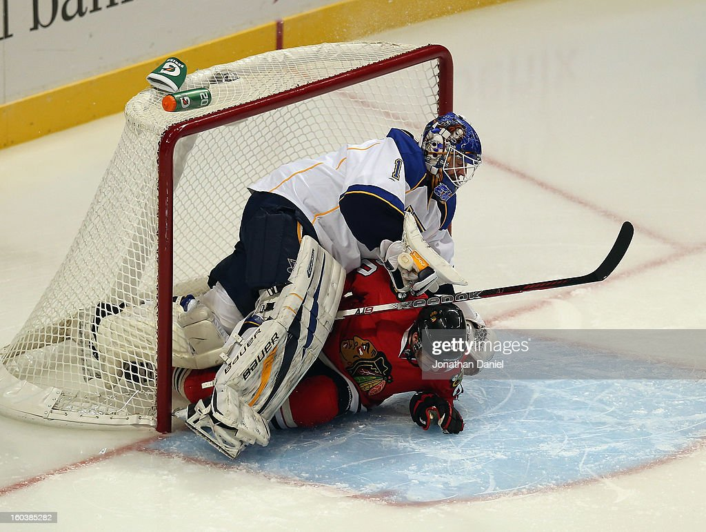 Brandon Saad #20 of the Chicago Blackhawks collides with <a gi-track='captionPersonalityLinkClicked' href=/galleries/search?phrase=Brian+Elliott&family=editorial&specificpeople=687032 ng-click='$event.stopPropagation()'>Brian Elliott</a> #1 of the St. Louis Blues at the United Center on January 22, 2013 in Chicago, Illinois. The Blackhawks defeated the Blues 3-2.