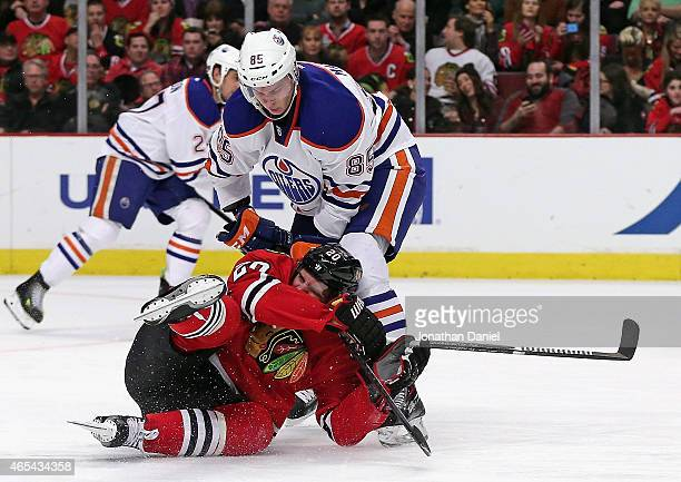 Brandon Saad of the Chicago Blackhawks crashes into Martin Marincin of the Edmonton Oilers in the second period at the United Center on March 6 2015...